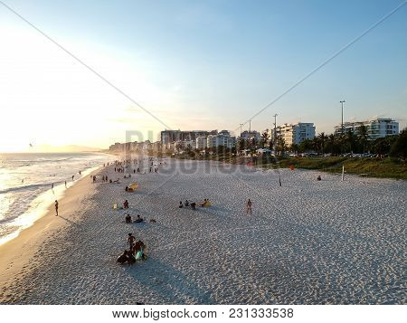 Drone Photo Of Barra Da Tijuca Beach, Rio De Janeiro, Brazil. We Can See The Beach, Some Buildings,