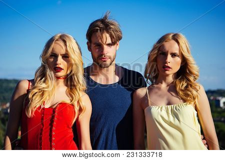 Twins Women With Macho On Blue Sky Background. Man With Beard With Twins, Relations. Family Trust, P