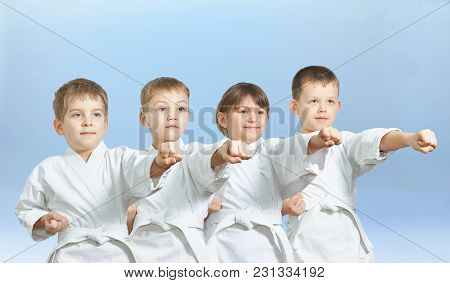 Four Little Athlete Are Beating Punch Arm