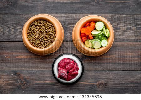 Ingredients For Dry Pet Food. Meat And Vegetables Zucchini And Carrot On Dark Wooden Backgroud Top V