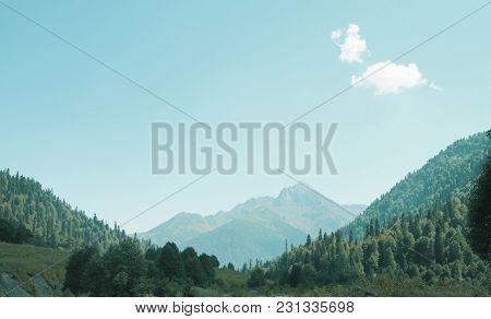 Picturesque Natural Landscape On Mountains. Panorama Of Green Forest On Mountainside In Foreground W