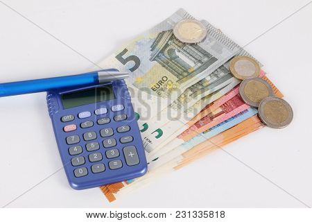 Calculator With A Pen And Different Euros Are Ling In The Studio