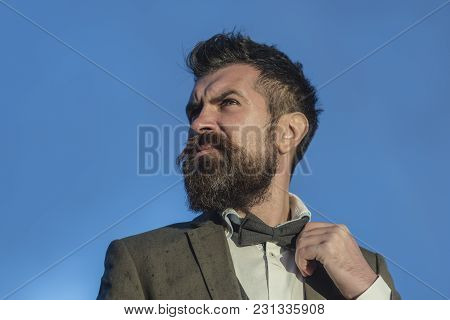 Man With Beard And Mustache With Blue Sky On Background. Guy With Thoughtful Face In Luxury Classic