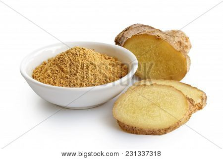 Finely Ground Dry Ginger In White Ceramic Bowl Isolated On White. Fresh Whole And Sliced Root Ginger