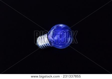 Electric Blue Light Bulb On Black Background