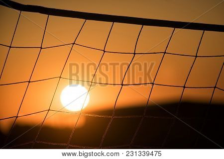 Orange Sunset - Sun Through Volleyball Net, Beach
