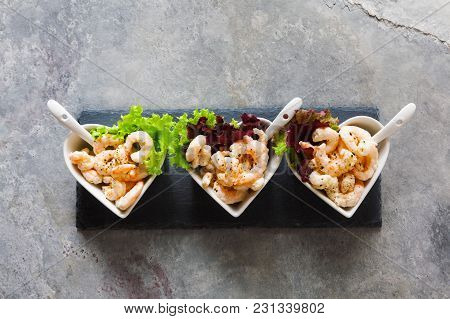 Prawn Cocktail  In Serving Bowls In The Form Of Hearts On A Gray Background. On A Black Serving Ston