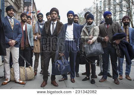 London - February 18: Stylish Sikh Men Poses For Photographers  Outside Somerset House During London
