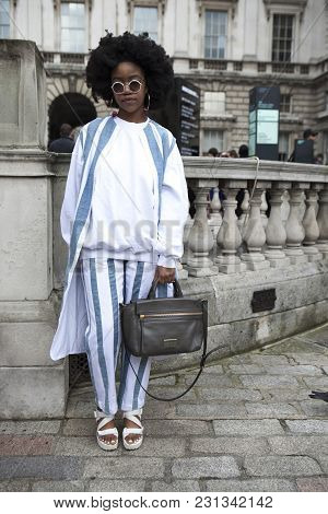 London - February 18: Woman In White And Blue Coat And  Poses For Photographers Outside Somerset Hou