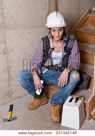 Female Construction Worker Drinking Beer After Hard Work Day