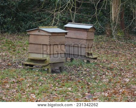 2 Wooden Bee Hives In A Field Near Liverpool