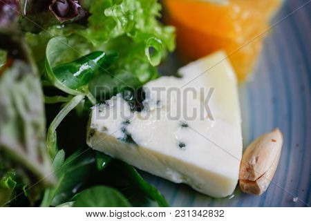 Roquefort Cheese Cut Out With Oranges And Greens. Appetizer, Salads. Healthy Food.  Restaurand And H
