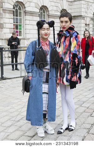 London - February 18: Stylish Women In Blue Jean Clothes Coat And Color Fur Coat And White Tights Du