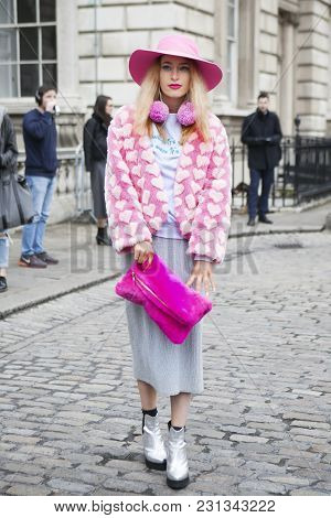 London - February 18: Stylish Woman In Pink Furs Coat And Pink Hat During London Fashion Week On Feb