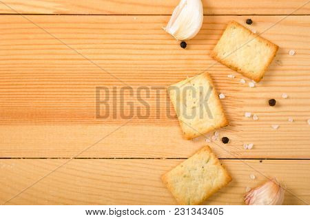 Salted Snacks With Pepper, Salt, Greens On A Wooden Table. Background