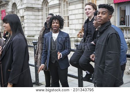 London - February 18: Young Man Models  Poses For Photographers With Silver Rings  Outside Somerset