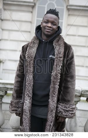 London - February 18: Man In Fur Coat Poses For Photographers With Silver Rings  Outside Somerset Ho