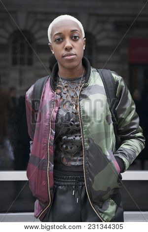 London - February 18: Blond Woman In Green Coat  Poses For Photographers With Silver Rings  Outside