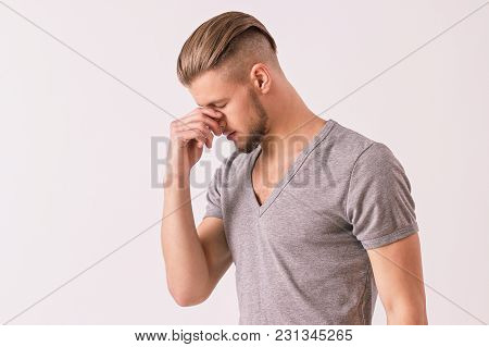 Dissapointed Young Man Touching His Head With Hand While Isolated On White Background. Attractove Hi