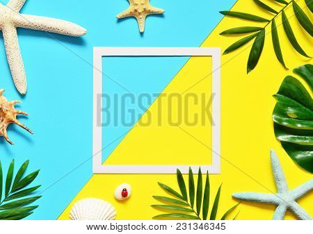 Tropical Background. Palm Trees Branches With Starfish And Seashell On Yellow And Blue Background. T