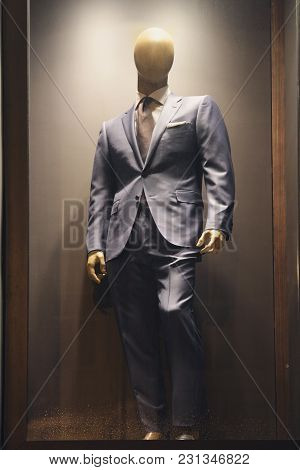 Male Mannequin In A Suit In A Shop Window