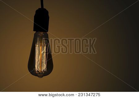 Vintage Hanging Edison Light Bulb Over Dark Background