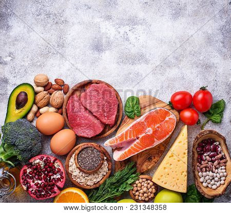 Healthy Food And Superfood Background. Meat, Fish, Legumes, Nuts, Seeds, Greens, Oil And Vegetables