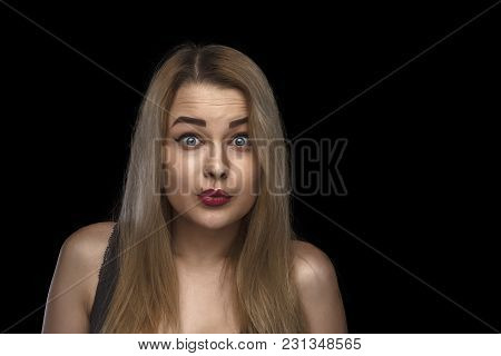 Beauty Portrait Of Girl In Glasses Looking At Camera And Kissing Air. Head And Shoulders Of Beautifu