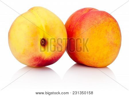 Two Nectarine Fruit With Green Leaf Isolated On A White Background