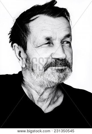 Satisfied moustached elderly man close-up black and white portrait