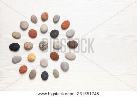 Pattern Of Natural Multicolored Pebbles On White Wooden Background. Spa Decoration. Meditation And R