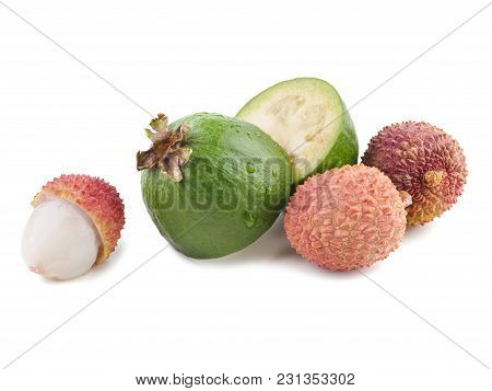 Fresh Exotic Fruits Flat Lay On A White Background.feijoa And Lichee