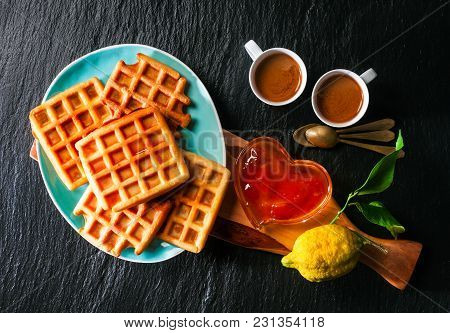 Breakfast With Belgian Waffles, Apricot Jam And Coffee On A Black Stone Background