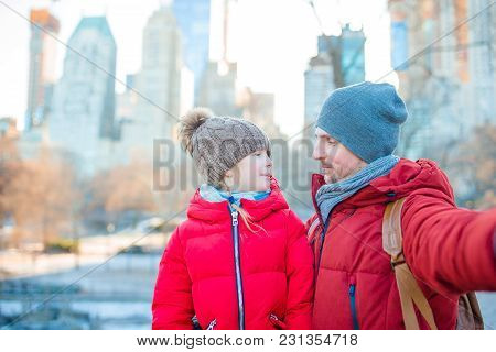 Adorable Little Girl And Dad Have Fun In Central Park At New York City