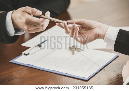 Close-up Of Hands With A Pen To Signing A Contract.