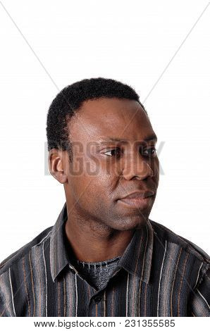 A Close Up Image Of An African American Man In A Striped Shirt Looing Away Und Serious, Isolated For