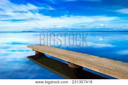 Pier Or Jetty, Sunset Blue Panoramic Landscape. Orbetello Lagoon With Reflection, Argentario, Tuscan