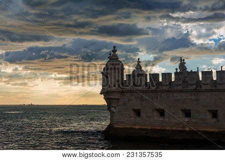 Belem Tower Medieval Battlement With Ocean And Wonderful Sky At Sunset, Near Lisbon In Portugal