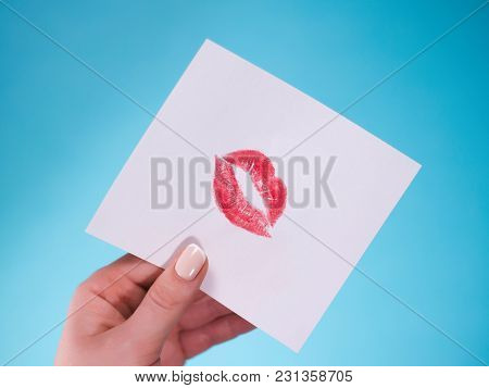 Flat Lay. Top View. Hand Of Girl Writing Love Letter On Saint Valentines Day. Handmade Postcard With