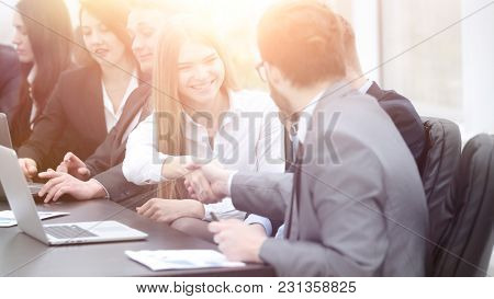 Manager and client greet each other with a handshake