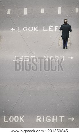 High Perspective View Of Sole Unidentifiable Pedestrian In The City Of London Crossing The Street. I