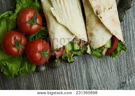 Two Shaurma Sandwiches Chicken Roll In A Pita With Fresh Vegetables Tomatoes , Cucumber, Latitude, C