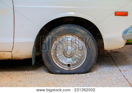 Wheel Flat Tire Of The Car Old With Copy Space Add Text