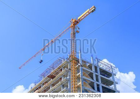 High Big Construction Site In Develop City And Tower Crane Working. With Copy Space Add Text