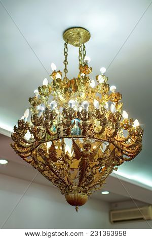 Big Bronze Chandelier In Cathedral Christian Church With Bulbs