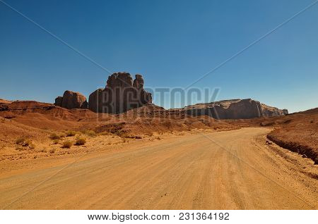 Road Going Through The Iconic Monument Valley In Arizona