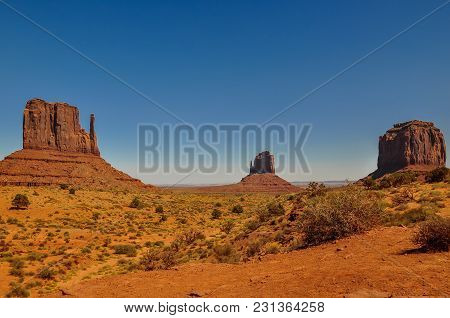 The Mittens And Merricks Butte, Rock Formations, In Monument Valley, Arizona