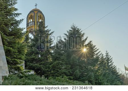 Haskovo, Bulgaria - March 15, 2014: Church Bell Tower Near Monument Of Virgin Mary In City Of Haskov