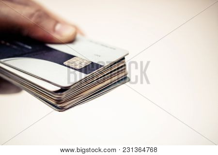 Hands Holding Many Credit Cards In Sad Tone / Credit Card Debt Problem