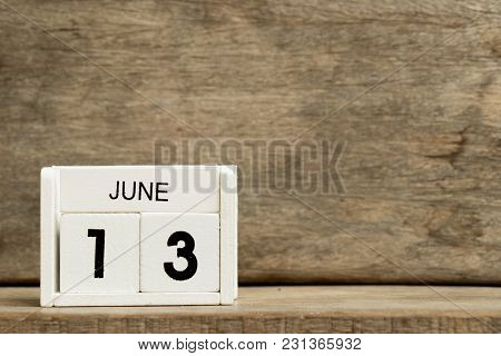 White Block Calendar Present Date 13 And Month June On Wood Background